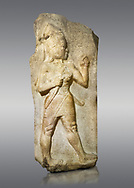 Picture & imafe of Relief of God of War. Limestone, Kings Gate, Hattusa ( Bogazkoy ). 14th - 13th Century BC. Anatolian Civilisations Museum, Ankara, Turkey.<br /> <br /> The warrior depicted in high relief is dressed in a decorated skirt. The relief takes place on the interior part of the King's gate facing city, to the east of the city walls. He carries a crescent-handled short sword in his belt. The relief is identified as god depiction since the horns on the headdress are the indication of a god.  <br /> <br /> Against a gray background..<br /> <br /> If you prefer to buy from our ALAMY STOCK LIBRARY page at https://www.alamy.com/portfolio/paul-williams-funkystock/hittite-art-antiquities.html  - Type Kings Gate  into the LOWER SEARCH WITHIN GALLERY box. Refine search by adding background colour, place, museum etc<br /> <br /> Visit our HITTITE PHOTO COLLECTIONS for more photos to download or buy as wall art prints https://funkystock.photoshelter.com/gallery-collection/The-Hittites-Art-Artefacts-Antiquities-Historic-Sites-Pictures-Images-of/C0000NUBSMhSc3Oo