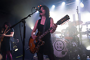 Lead singer and guitarist Miki Berenyi of seminal Indie Shoegaze band Lush as they play their first live concert in twenty years on 11th April 2016 at Oslo in Hackney, London, England, United Kingdom. Emma Anderson vocals, guitar in background. This was an intimate warm up gig prior to their two upcoming shows at a far larger venue. Lush are an English alternative rock band, formed in 1987, disbanded in 1998, and reunited in 2015. They were one of the first bands to have been described with the shoegazing label. Later, their sound moved toward Britpop.