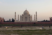 Children playing cricket in front of The Taj Mahal, a UNESCO World Heritage Site, at Agra, India