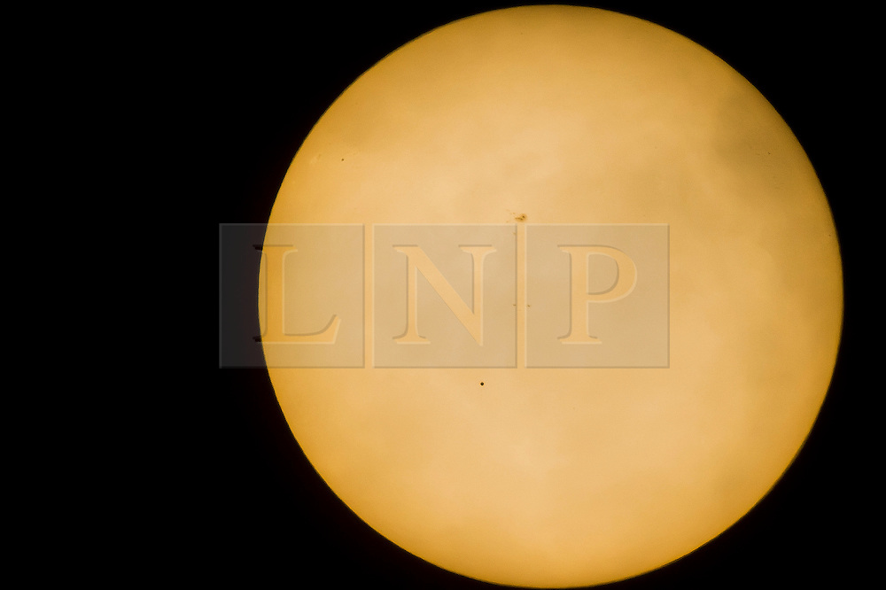 © Licensed to London News Pictures. 09/05/2016. London, UK. The planet Mercury seen making a transit across the Sun. Mercury is seen here moving across the Sun for the first time in 10 years and will not make its next transit until 2019 and then 2032. Photo credit : David Tett/LNP