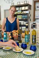 Tasting olive oils at the olive oil estate and producer Bastide du Laval in Cadanet, France.