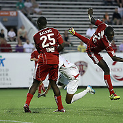 Richmond Defender Yomby William (2) gets tripped by Orlando City Lions Forward Maxwell Griffin (11) during a United Soccer League Pro soccer match between the Richmond Kickers and the Orlando City Lions at the Florida Citrus Bowl on May 25, 2011 in Orlando, Florida.  (AP Photo/Alex Menendez)