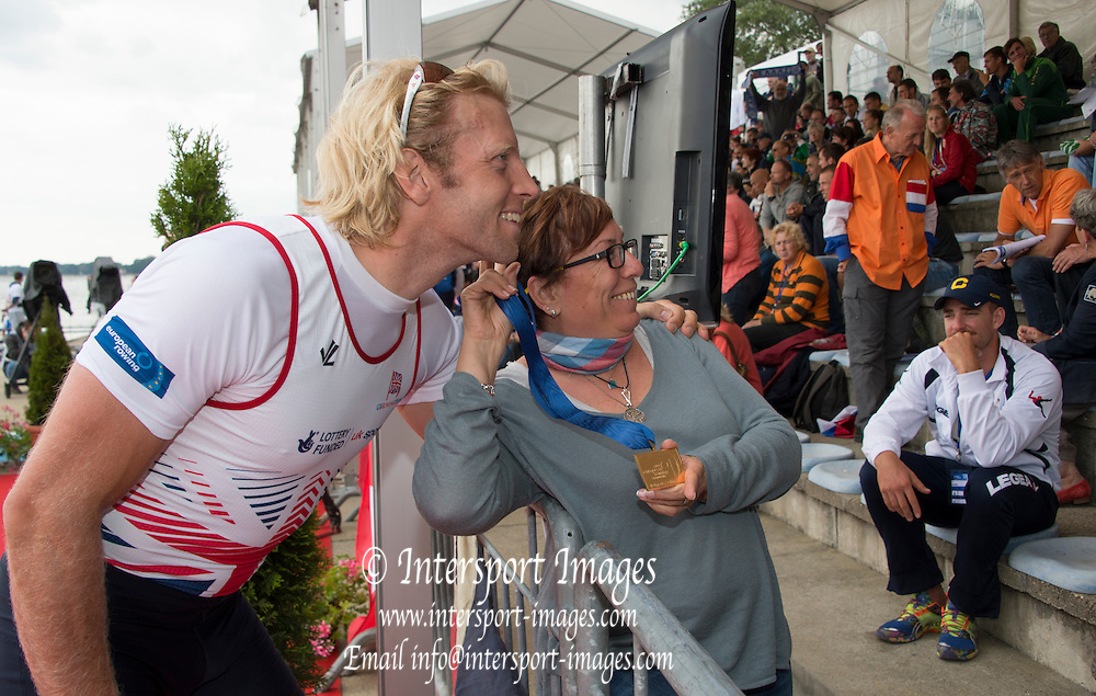 Belgrade, SERBIA,  A Finals GBR M4-. Andy TRIGGS HODGE,  poses with a fan at the 2014 FISA  at the 2014 FISA European Rowing Championships. Lake Sava. <br /> <br /> <br /> 12:49:41  Sunday  01/06/2014<br /> <br /> [Mandatory Credit; Peter Spurrier/Intersport-images]