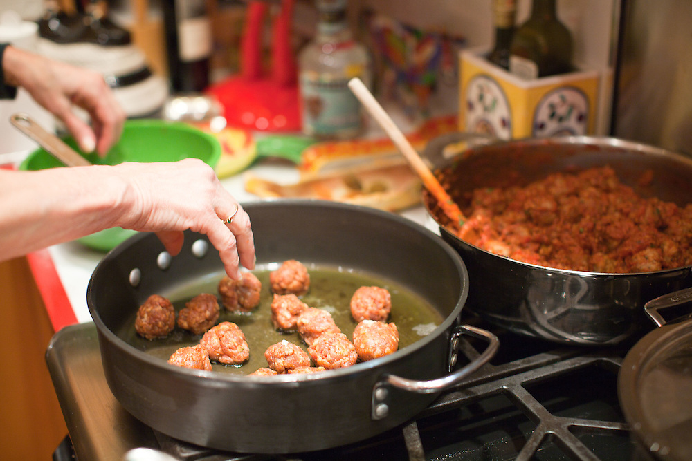 Sausage and meatballs. - Rep. Rosa DeLauro (D-CT) cooks dinner at her home on Saturday, April 9, 2011 in Washington. (Photo by Jay Westcott/Politico)
