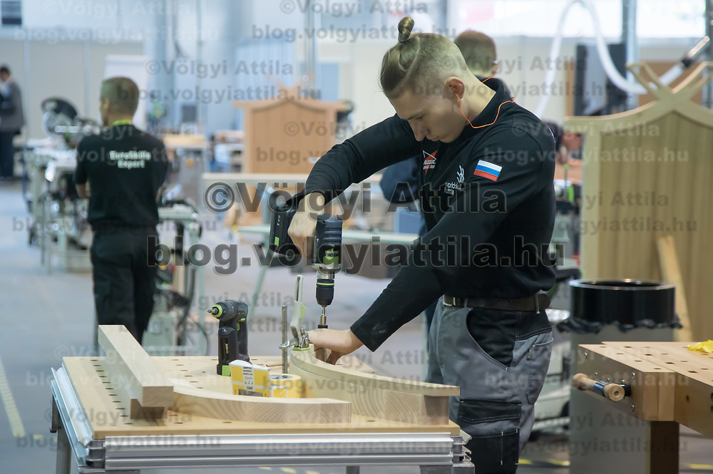 Participant competes in furniture making during the EuroSkills European Championship of young professionals in Budapest, Hungary on Sept. 26, 2018. ATTILA VOLGYI