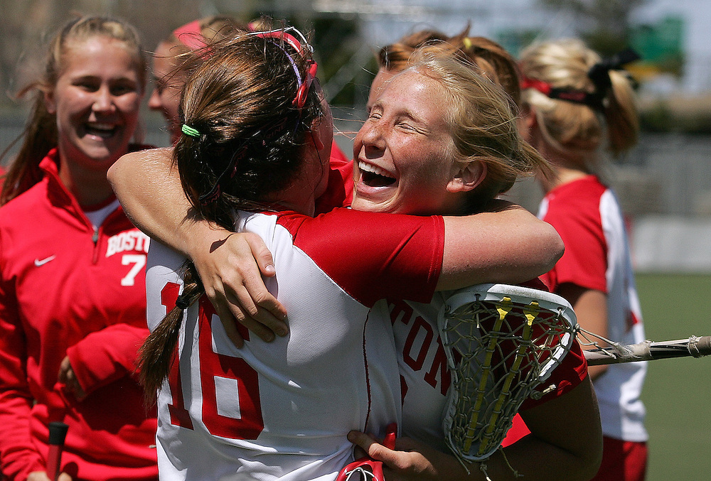 (051108 Boston, MA)  From left, Boston University's Mandy Rogers, #16, hugs Alyssa Kovach, #22, after they won their game against UNH during the division I NCAA Lacrosse Championships.