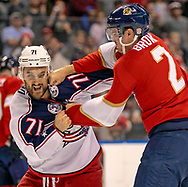 Florida Panthers defenseman Josh Brown (2) punches Columbus Blue Jackets left wing Nick Foligno (71) during fight on the ice in the first period as the Florida Panthers host the Columbus Blue Jackets at the  BB&T Center in Sunrise on Saturday, December 7, 2019.