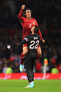 Bruno Alves of Portugal celebrates the winning goal with Beto - Argentina vs. Portugal - International Friendly - Old Trafford - Manchester - 18/11/2014 Pic Philip Oldham/Sportimage