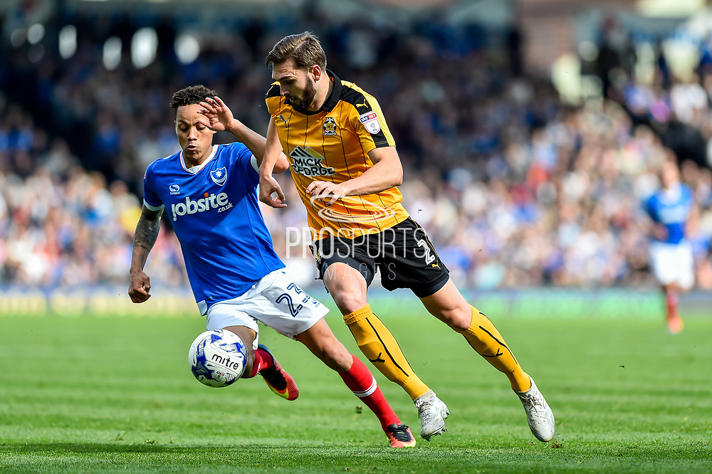 Cambridge United Defender, Greg Taylor (2) and Portsmouth Midfielder, Kyle Bennett (23) during the EFL Sky Bet League 2 match between Portsmouth and Cambridge United at Fratton Park, Portsmouth, England on 22 April 2017. Photo by Adam Rivers.