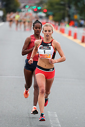 2018 Reebok 10K For Women<br /> <br /> photo © Kevin Morris<br /> kevinmorris@mac.com<br /> 207-522-5807 Emily Sisson of Providence, RI, pushes the pace as she leads the all-women's 10K in Boston, MA, with Buze Diriba of Ethiopia shadowing her a half step back. As the race progressed Sisson extended her lead and was victorious in the 10K race, claiming the $9000 prize.