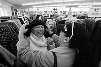 CLINTON, CT - 26 DECEMBER 2007 -111608JT16-.Marie Tyrrell shops for fabrics to make a scarf for her shaved head with her granddaughter Mysti Keller, background, and Marie's daughter Tracie Marcil on Dec. 26, 2007 at a Jo-Ann Fabric store in Clinton. In her fourth round of chemotherapy, this was the second time Marie shaved her head since being diagnosed with lung cancer in 2006..Josalee Thrift / Republican-American