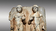 Close up of a Roman Sebasteion relief  sculpture of  Two princes, Aphrodisias Museum, Aphrodisias, Turkey.<br /> <br /> Two princes stand like statues, naked, wearing cloaks. The left figure holds the orb of the world in one hand, a symbol of  world rule that indicates he is the imperial heir, and in the other a ship's stern ornament (aphlaston), a symbol of naval victory. They and probably Gius and Lucius, the grandsons of Augustus, or Nero and Britanicus, Claudius' heir. .<br /> <br /> If you prefer to buy from our ALAMY STOCK LIBRARY page at https://www.alamy.com/portfolio/paul-williams-funkystock/greco-roman-sculptures.html . Type -    Aphrodisias     - into LOWER SEARCH WITHIN GALLERY box - Refine search by adding a subject, place, background colour, museum etc.<br /> <br /> Visit our ROMAN WORLD PHOTO COLLECTIONS for more photos to download or buy as wall art prints https://funkystock.photoshelter.com/gallery-collection/The-Romans-Art-Artefacts-Antiquities-Historic-Sites-Pictures-Images/C0000r2uLJJo9_s0