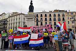 June 16, 2017 - Madrid, Madrid, Spain - Paraguayan citizens protest for a fair trial for the Curuguaty massacre in Opera's square, Madrid. Five years ago, 300 heavily-armed police officers stormed into Marina Kue in the Curuguaty district of Paraguay in an attempt to evict 70 farm workers who had occupied the land. The conflict, which swiftly turned violent, resulted in the deaths of 17 people, 11 landless and six policemen. (Credit Image: © M. Ramirez/Pacific Press via ZUMA Wire)