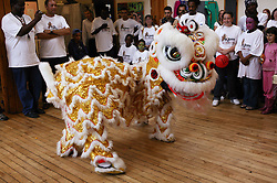 Chinese Dragon performing to audience at the St Anns; Nottingham Holding Hands festival,