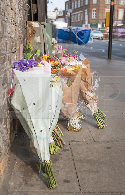 © Licensed to London News Pictures. 17/10/2017. London, UK. Floral tributes are left near where a man was stabbed. Police are investigating after a man in his 20's was stabbed to death and two others were injured in an incident on Monday night outside Parsons Green underground station a terrorist attack took place last month. Photo credit: Peter Macdiarmid/LNP