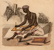 Indian gilder applying gold leaf to a frame.  Before gold leaf was burnished on, size had to be applied. Hand-coloured engraving published Rudolph Ackermann, London, 1822.