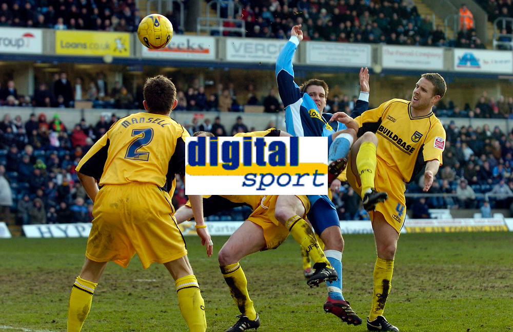 Photo: Richard Lane.<br />Wycombe Wanderers v Oxford United. Coca Cola League 2. 25/02/2006. <br />Wycombe's Dean Bowditch is challenged by Oxford's Stuart Gray and Barry Quinn.