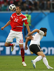 June 19, 2018 - Saint Petersburg, Russia - Artem Dzyuba (L) of the Russia national football team vie for the ball during the 2018 FIFA World Cup match, first stage - Group A between Russia and Egypt at Saint Petersburg Stadium on June 19, 2018 in St. Petersburg, Russia. (Credit Image: © Igor Russak/NurPhoto via ZUMA Press)