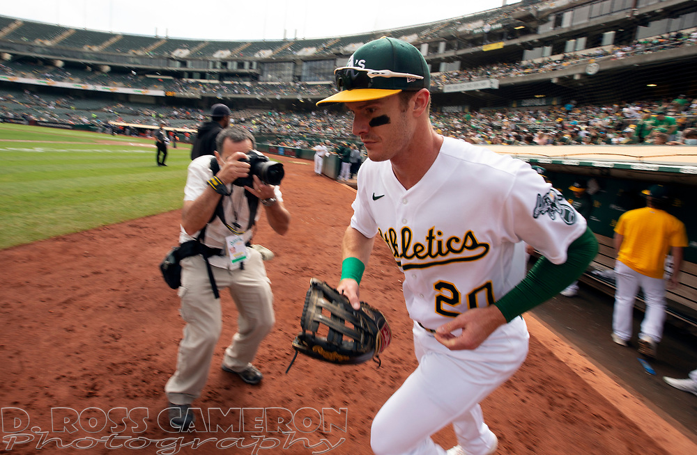 Sep 26, 2021; Oakland, California, USA; Oakland Athletics left fielder Mark Canha (20) takes the field against the Houston Astros in the first inning at RingCentral Coliseum. Mandatory Credit: D. Ross Cameron-USA TODAY Sports