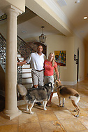 WINTER PARK, FLORIDA-SEPTEMBER 12: Boston Celtics head coach Doc Rivers, left, and wife Kris with their dogs Ellie, left, and Mickey inside their home September 13, 2006, in Winter Park, Fla. (Photo by Phelan M. Ebenhack)
