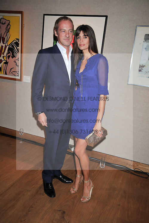ANTON & LISA BILTON at fundraising dinner and auction in aid of Liver Good Life a charity for people with Hepatitis held at Christies, King Street, London on 16th September 2009.