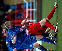 Photo: Ian Hebden.<br />Rushden & Diamonds v Grimsby Town. Coca Cola League 2. 04/03/2006.<br />Rushden's Ronnie Bull (R) and Grimsby's Paul Bolland (C) tangle for the ball, while Grimsby's Gary Jones (L) looks on.