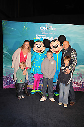 """SALLY GUNNELL and her husband JONATHAN BIGG with their children, left to right,  MARLEY, FINLEY and LUCA photographed with Micky Mouse & Minnie Mouse at a VIP Opening night of Disney & Pixar's """"Finding Nemo on Ice"""" at The O2 Arena Grennwich London on 23rd October 2008."""