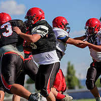081715  Adron Gardner/Independent<br /> <br /> Grants Pirate offensive and defensive lines clash during football practice at Grants High School Monday.