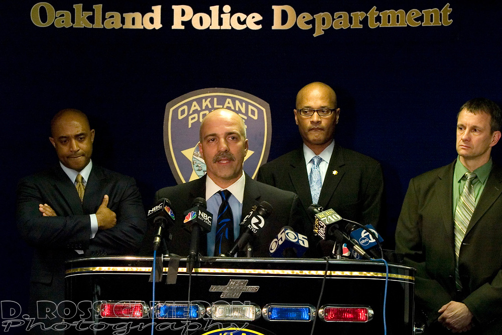 Oakland, Calif. police Capt. Ben Farow, second from left, tells the media about the findings of an independent panel in the case of the shooting deaths of four Oakland officers at the hands of a convicted felon in March 2009, during a press conference at police headquarters Wednesday, Jan. 6, 2010. Chief Anthony Batts, from left, Deputy Chief Howard Jordan and Lt. Brian Medeiros listen. (D. Ross Cameron/Staff)