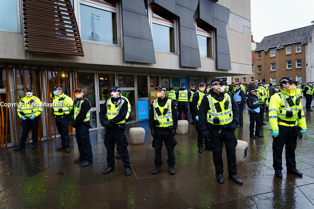Edinburgh, Scotland, UK. 11 January 2020. Protester arrested in violent scenes at anti lockdown demonstration at Scottish Parliament in Edinburgh today. Several protesters took part but  a heavy and aggressive police presence prevented demonstration and planned march to Bute House. During national Covid-19 lockdown such protests are illegal and police advised people not to attend the demonstration. Iain Masterton/Alamy Live News