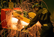 Alaska. Prudhoe Bay. Pipe fitter wears protective equipment while cutting pipe.