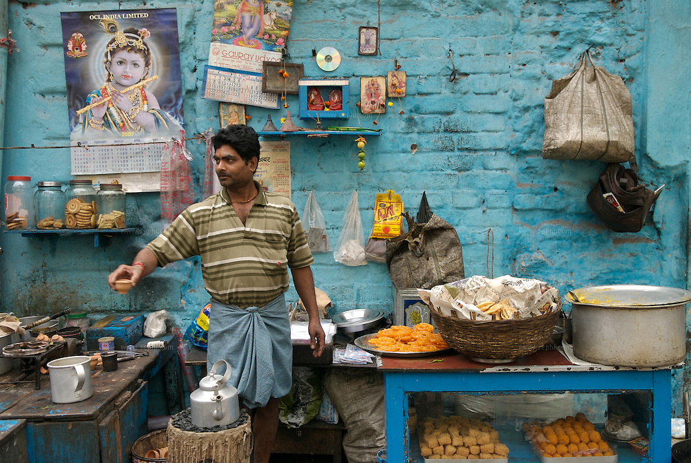 A vendor at a  road side food stall  selling sweets and chai in cley pots (kulhars) in Kolkata