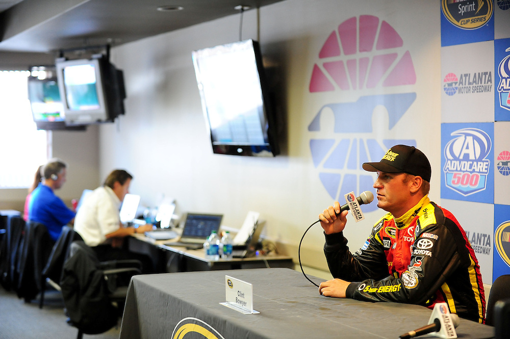August 31, 2012; Hampton, GA, USA; NASCAR Sprint Cup Series driver Clint Bowyer talks to the media during practice for the AdvoCare 500 at Atlanta Motor Speedway. Photo by Kevin Liles/kevindliles.com