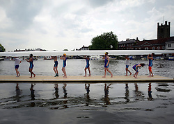 © Licensed to London News Pictures. 28/06/2012. Henley-on-Thames, UK Rowing crews lift there boats out of the water. Spectators watch rowing crews compete at the Henley Royal Regatta on June 28, 2012 in Henley-on-Thames, England. The 173-year-old rowing regatta is held 27th June- 1st July 2012. Photo credit : Stephen Simpson/LNP
