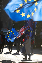 © Licensed to London News Pictures. 13/12/2018. London, UK. EU demonstrators wave flags outside the Houses of Parliament. Yesterday, British Prime Minister Theresa May won the backing of her party to stay on as Prime Minister, following a vote of no confidence, after she postponed the vote on her EU withdrawal deal. Photo credit : Tom Nicholson/LNP