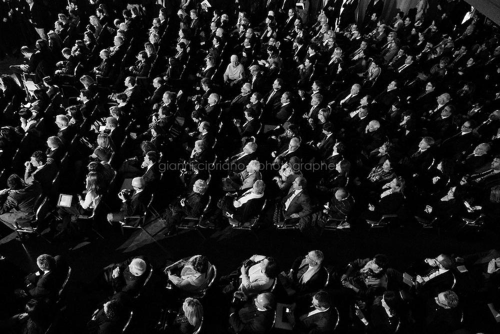 """ROME, ITALY - 24 JANUARY 2013: Candidates of Silvio Berlusconi's People of Freedom party (PdL, Popole della Libertà)  listen to their leader's speech during a convention in which the former PM and leader of The People of Freedom party presents the PdL candidates for the upcoming general elections in Rome, on January 25, 2013.<br /> <br /> A general election to determine the 630 members of the Chamber of Deputies and the 315 elective members of the Senate, the two houses of the Italian parliament, will take place on 24–25 February 2013. The main candidates running for Prime Minister are Pierluigi Bersani (leader of the centre-left coalition """"Italy. Common Good""""), former PM Mario Monti (leader of the centrist coalition """"With Monti for Italy"""") and former PM Silvio Berlusconi (leader of the centre-right coalition).<br /> <br /> ###<br /> <br /> ROMA, ITALIA - 24 GENNAIO 2013: I candidati del Popolo della Libertà di Silvio Berlusconi ascoltano il loro leader durante una convention in cui l'ex-premier e leader del Popolo della Libertà presenta i candidati PdL alle prossime elezioni politiche, a Roma il 24 gennaio 2013.<br /> <br /> Le elezioni politiche italiane del 2013 per il rinnovo dei due rami del Parlamento italiano – la Camera dei deputati e il Senato della Repubblica – si terranno domenica 24 e lunedì 25 febbraio 2013 a seguito dello scioglimento anticipato delle Camere avvenuto il 22 dicembre 2012, quattro mesi prima della conclusione naturale della XVI Legislatura. I principali candidate per la Presidenza del Consiglio sono Pierluigi Bersani (leader della coalizione di centro-sinistra """"Italia. Bene Comune""""), il premier uscente Mario Monti (leader della coalizione di centro """"Con Monti per l'Italia"""") e l'ex-premier Silvio Berlusconi (leader della coalizione di centro-destra).ROME, ITALY - 24 JANUARY 2013: Silvio Berlusconi, former PM and leader of The People of Freedom party, and Angelino Alfano, Secretary of the party, present the PdL candidates for the upcoming """