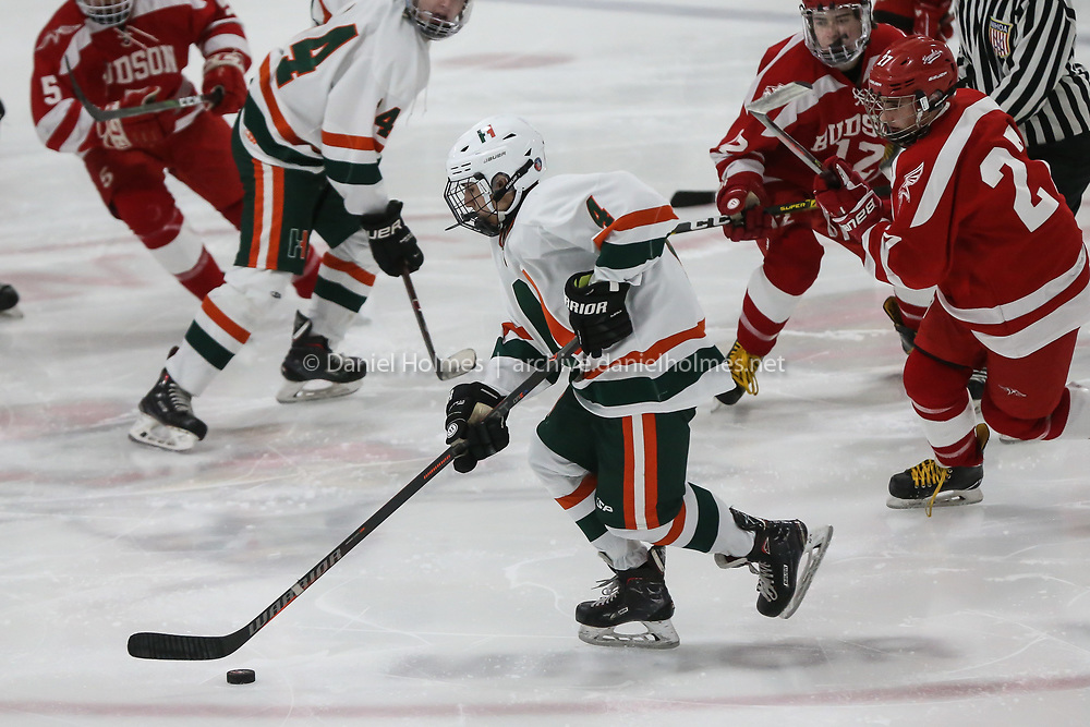 (12/28/19, MARLBOROUGH, MA) Hopkinton's Pavit Mehra takes the puck up the ice during the first round of the 20th annual Daily News Cup against Hudson at New England Sports Center in Marlborough on Saturday. [Daily News and Wicked Local Photo/Dan Holmes]