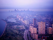 Misty morning aerial view of downtown Chicago from above Lincoln Park and Lake Shore Drive, Chicago, Illinois.
