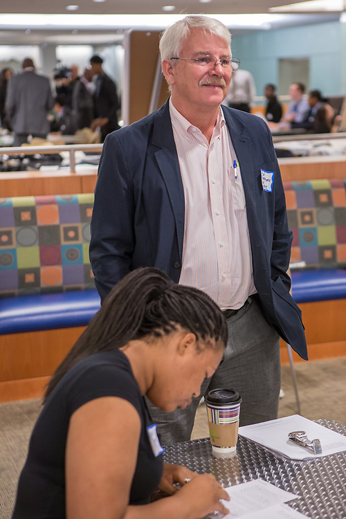 Purchase, NY – 31 October 2014. Port Chester High School student Imani Sobmon writes notes as her faculty advisor looks on.  Business Skills Olympics was founded by the African American Men of Westchester, is sponsored and facilitated by Morgan Stanley, and is open to high school teams in Westchester County.