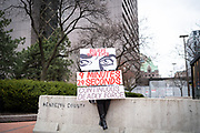 A demonstrator holds a sign outside the Hennepin County Government Center in Minneapolis, Minnesota, on Monday, April 19, 2021.