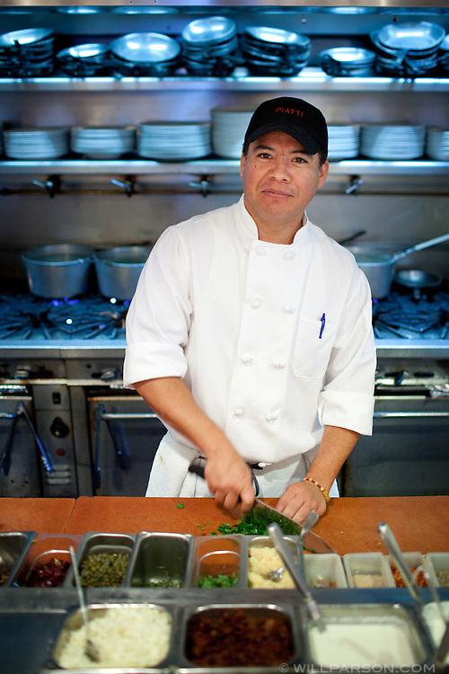 Sous-chef Rafael Partida works the open kitchen at Piatti La Jolla.