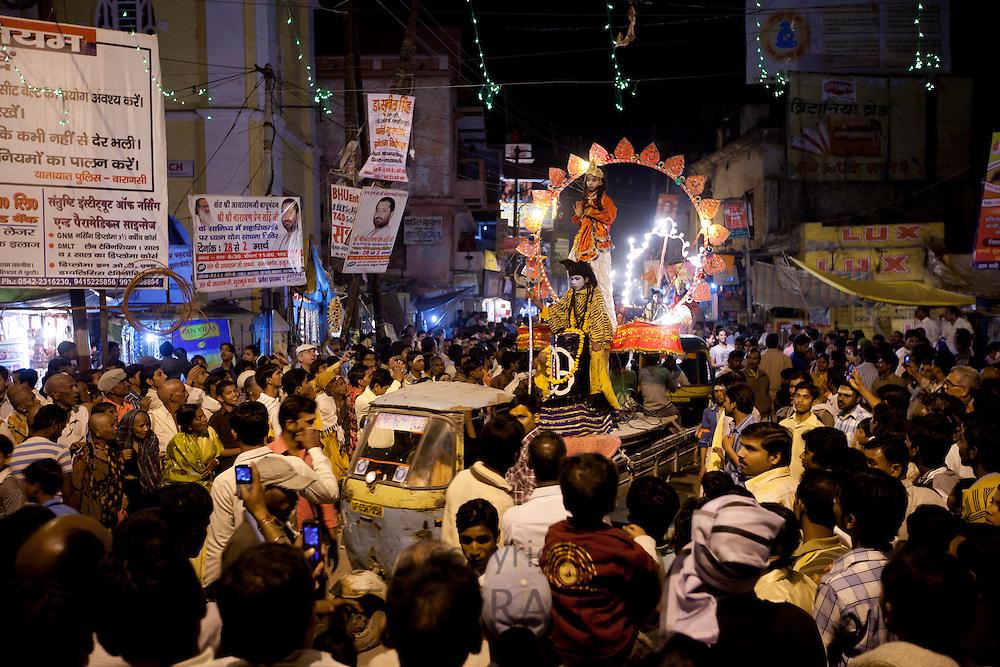 Lord Shiva and Parwati characters parade through crowd at Festival of Shivaratri in the holy city of Varanasi, Benares, Northern India