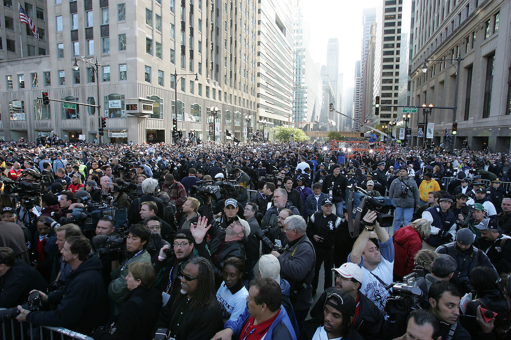 CHICAGO - OCTOBER 28:  The Chicago White Sox ride in a motorcade through Chicago neighborhoods and down LaSalle street in a ticker tape parade after winning the 2005 World Series, sweeping the Houston Astros in 4 games on October 28, 2005 in Chicago, Illinois.  The City of Chicago estimated that 1.75 million people lined the parade route.