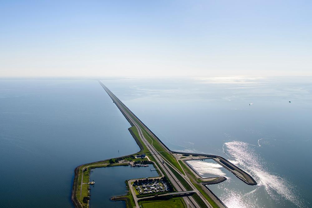 Nederland, Friesland, Gemeente Wonseradeel, 07-05-2018; Afsluitdijk ter hoogte van Breezanddijk, het voormalig werkeiland Breezand. Camping voor zeevissers. Gezien naar de kust van Noord-Holland, aan de horizon. Waddenzee rechts, IJsselmeer links.<br /> Enclosure Dam at the height of Breezanddijk, former 'work island' Breezand, seen in the direction of the Noord-Holland coast at the horizon (32 kilometers away). IJsselmeer lake (right), the Wadden Sea (left)<br /> luchtfoto (toeslag op standard tarieven);<br /> aerial photo (additional fee required);<br /> copyright foto/photo Siebe Swart