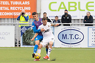 Cove Rangers' Mitchel Megginson (9) battles for possession, tussles, tackles, challenges, during the Premier Sports Scottish League Cup match between Cove Rangers and Inverness CT at Balmoral Stadium, Aberdeen, Scotland on 20 July 2021.