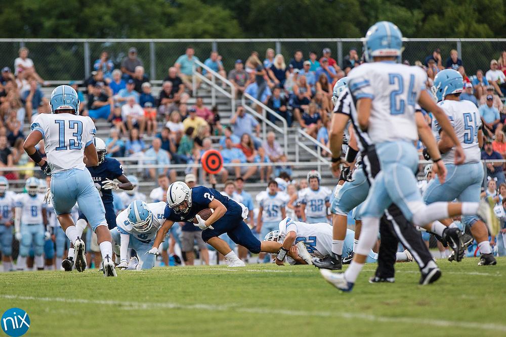 Quarterback Trevor Shue scrambles for yardage against a tough Piedmont Panthers' defense.