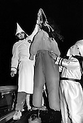 Ku Klux Klan members simulate the lynching of an African American with a gorilla masked dummy at a Klan Rally outside Jackson, Georgia. The rally - held in a rural farm field - attracted about 125 people and attempted to both incite violence against blacks and enlarge the local KKK membership.