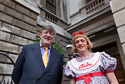 © Licensed to London News Pictures. 07/06/2012. LONDON, UK. Television presenter, and trustee of the Royal Academy, Stephen Fry (L) and artist Grayson Perry (R) stand in the courtyard of the Royal Academy today (07/06/12) ahead of unveiling plans for the Keeper's House. The Keeper?s House is a major new building project to create beautiful new spaces alongside the Royal Academy for RA Friends, Royal Academicians and the general public in the heart of London. Photo credit: Matt Cetti-Roberts/LNP