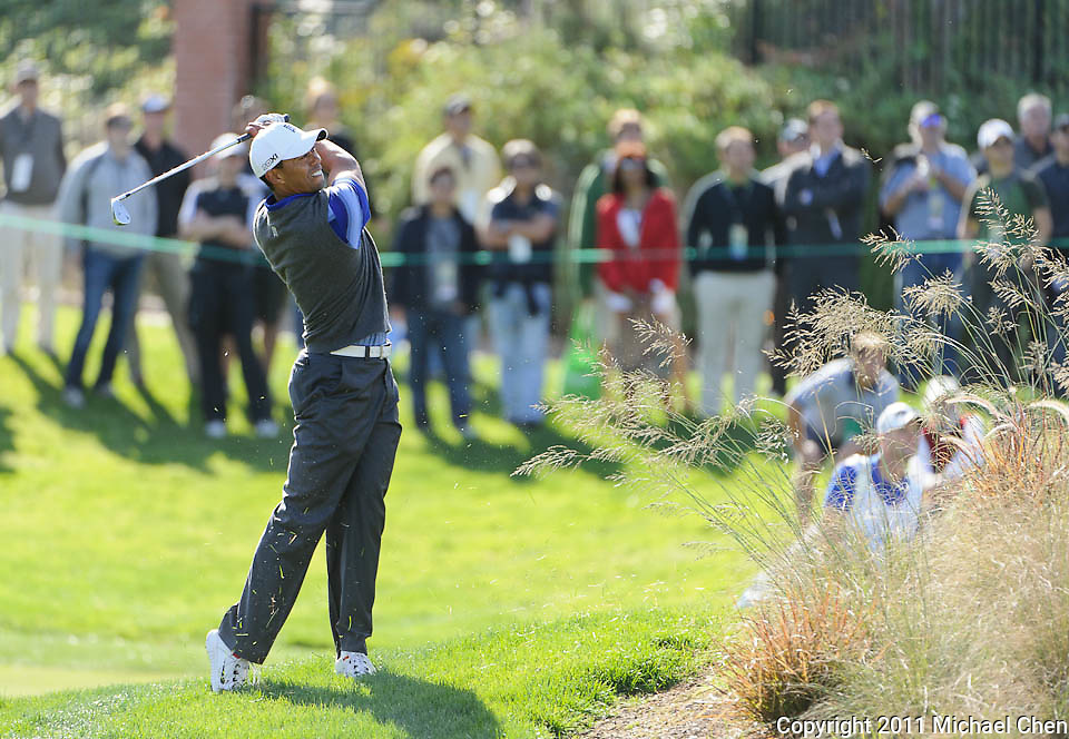 Tiger Woods hits his approach shot on hole 7 during Round 2 of the 2011 Chevron World Challenge at the Sherwood Country Club in Thousand Oaks, Calif., on Friday, Dec. 2, 2011.