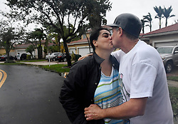 """The Vineyards in Monarch Lakes President Felix Carballo kisses his wife, Cristina, in relief after Hurricane Irma passed and they saw their house and the community was spared major damage other than down trees, branches and mailboxes in the West Miramar community on Sunday, September 10, 2017. """"As soon as I could get out I came and started clearing the drains to prevent flooding,"""" said Carballo. """"Thank God we didn't get major damage. Photo by Taimy Alvarez/Sun Sentinel/TNS/ABACAPRESS.COM"""